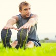 Young man stretching before exercise — Stock Photo #39662099