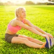 Young woman stretching before exercise — Stock Photo