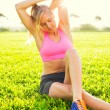 Attractive fit young woman stretching — Stock Photo