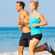 Couple running on the beach — Stock Photo #39662513