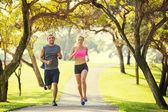 Couple running in park — Stock Photo