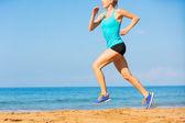 Woman running on beach — Stock Photo