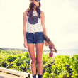 Beautiful young woman with a skateboard — Stock Photo #40057279