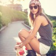 Stock Photo: Beautiful young womwith skateboard