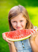 Girl eating watermelon — Stock Photo