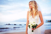 Beautiful bride by the beach — Stock Photo