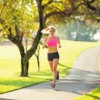 Woman running in the park — Stock fotografie