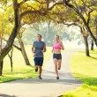 Couple running together in the park — Stock Photo