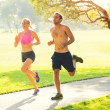 Couple running together in the park — Stock Photo #40878641
