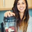 Stock Photo: Woman with Fruit smoothie