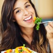 Stock Photo: Womeating salad