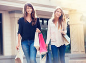Beautiful girls with shopping bags  — Стоковое фото
