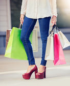 Woman holding shopping bags at the mall — Foto de Stock