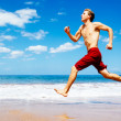 Athletic Man Running on Beach — Stok fotoğraf