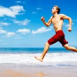 Athletic Man Running on Beach — Zdjęcie stockowe