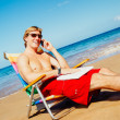 Businessman Relaxing at the Beach with Laptop Computer — Stock Photo #43700815