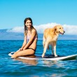 Young Woman Surfing with Her Dog — Stock Photo