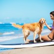 Woman at the Beach with her Dog — Stock Photo #43702665