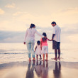 Happy Young Family on Beach at Sunset — Stock Photo #43703007