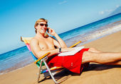 Businessman Relaxing at the Beach with Laptop Computer — Stock Photo