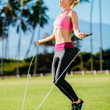 Woman Exercising Jumping Rope — Stock Photo #44316249