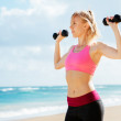 Fitness woman with barbells working out — Stock Photo #44316479