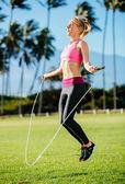 Woman Exercising Jumping Rope — Stock Photo
