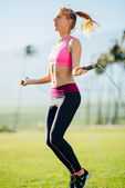 Woman Exercising Jumping Rope — Stock Photo