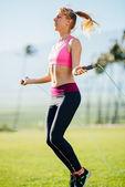 Woman Exercising Jumping Rope — Foto Stock