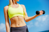 Fitness woman with barbells working out — Stock Photo