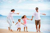 Family walking on the beach — Stock Photo