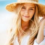 Portrait of beautiful blond girl on the beach — Stock Photo #44844271