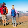 Hikers enjoying the view from the mountain top — Stock Photo #44845577