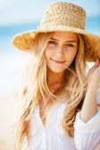 Portrait of beautiful blond girl on the beach — Stock Photo