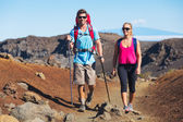 Hikers enjoying walk on amazing mountain trail — Photo