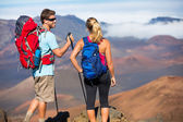 Hikers enjoying the view from the mountain top — Foto Stock