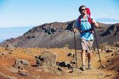Hiker enjoying walk on amazing mountain trail — Foto Stock