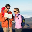 Hikers looking at trail map — Stock Photo #45245269