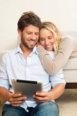 Young couple using tablet computer — Foto de Stock