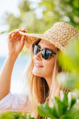 Woman in sun hat on the beach — Stock Photo