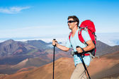 Hiker at mountain trail — Stock Photo