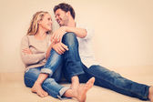 Happy young couple at home — Stock Photo