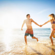 Happy couple on a tropical beach — Stock Photo #46242181