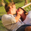 Couple relaxing in tropical hammock — Stockfoto