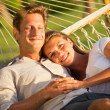 Couple relaxing in tropical hammock — Stock Photo #47044169