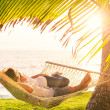Couple relaxing in tropical hammock — Stock Photo #47044217