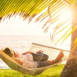 Couple relaxing in tropical hammock — Foto Stock #47044217