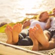 Couple relaxing in tropical hammock — Stockfoto #47044237