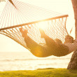 Couple relaxing in tropical hammock — Stok fotoğraf