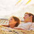 Couple relaxing in tropical hammock — Foto Stock #47044297